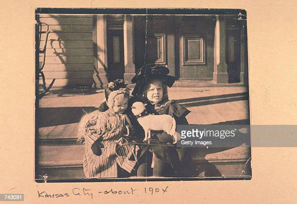 Baby picture of pilot Amelia Earhart with a dog a toy sled and her cousin Otis Balis Kansas City