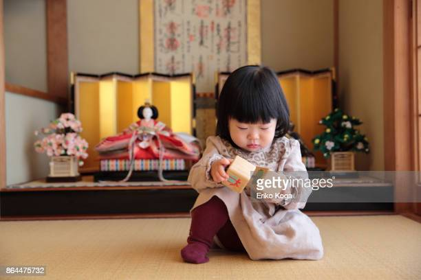 baby playing in front of hina dolls - hinamatsuri stock pictures, royalty-free photos & images