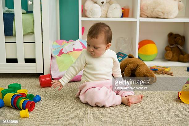 Baby playing in nursery