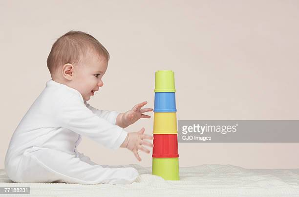 A baby playing with building toys
