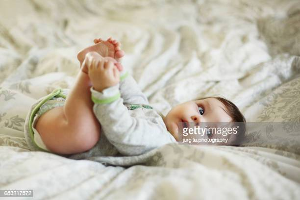 Baby playing with his feet