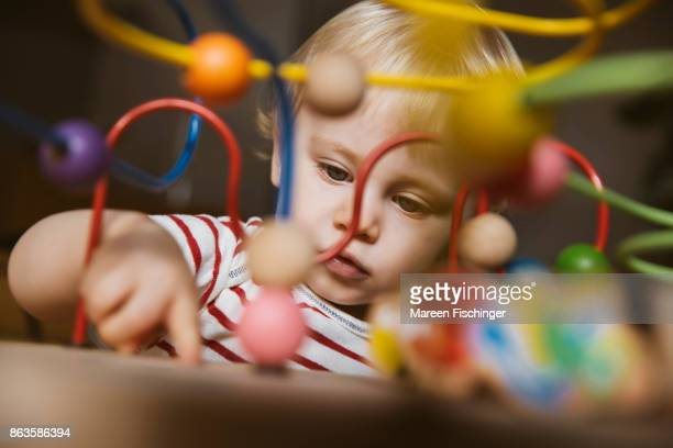 Baby playing with motor activity loop