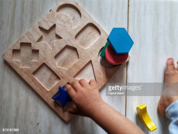 Baby playing with puzzles