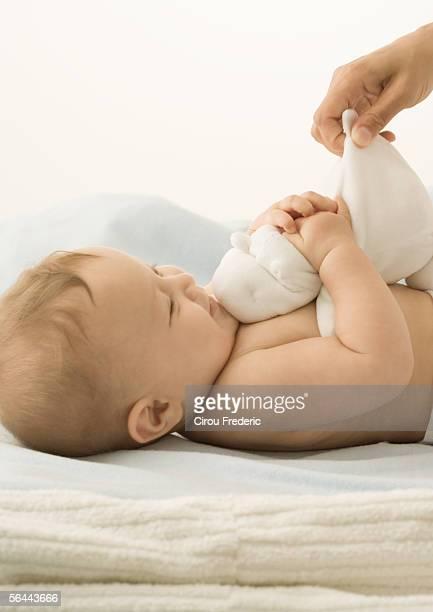 Baby playing with stuffed animal