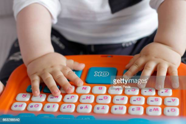 Baby playing with toy computer