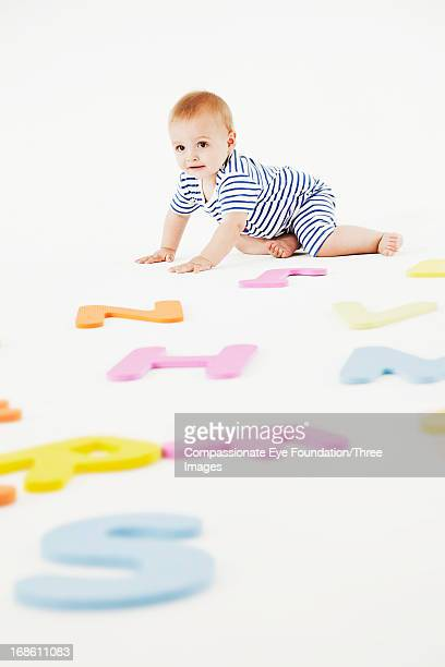 Baby playing with toy letters