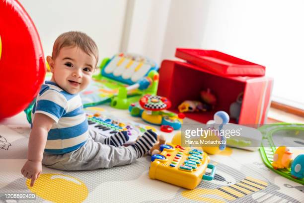 baby playing with toys - one baby boy only stock pictures, royalty-free photos & images