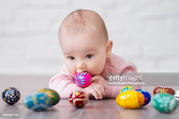 Baby playing with wooden easter eggs