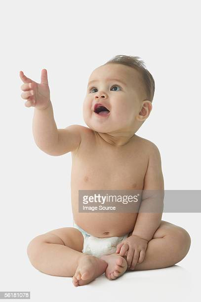 baby pointing - baby pointing stock photos and pictures