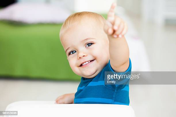 baby pointing with his finger - baby pointing stock photos and pictures