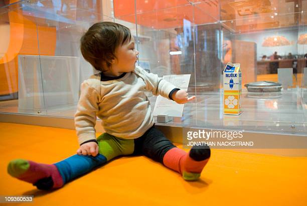 PREELA baby points at a plasticcoated milk carton with the logo from the Keep Nature Clean campaign the exhibition 'Garbage' at the 'Nordiska Museet'...