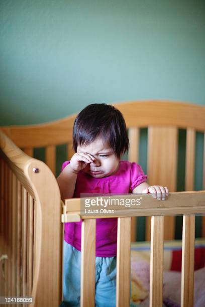 Baby pouting in crib
