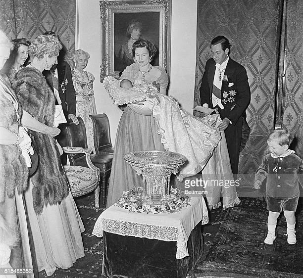 Baby Prince Ludwig Rudolph of Hanover is held by his mother the Duchess Ortrud after his baptism in a regal ceremony at Marienburg Castle Hanover...