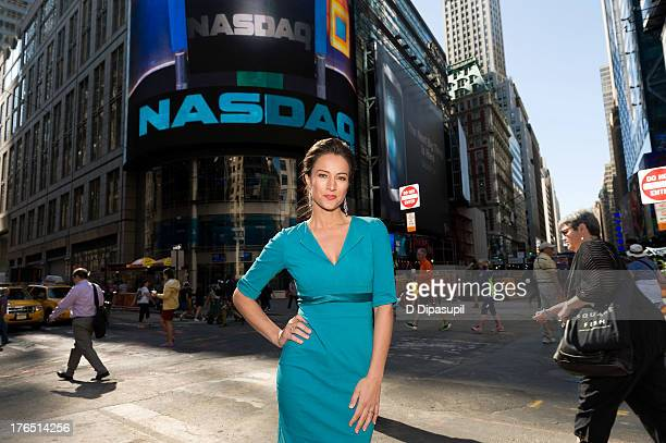 Baby Quest Foundation spokeswoman America Olivo rings the opening bell at the NASDAQ MarketSite on August 14 2013 in New York City