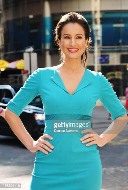 Baby Quest spokeswoman America Olivo rings the opening bell at the NASDAQ MarketSite on August 14 2013 in New York City