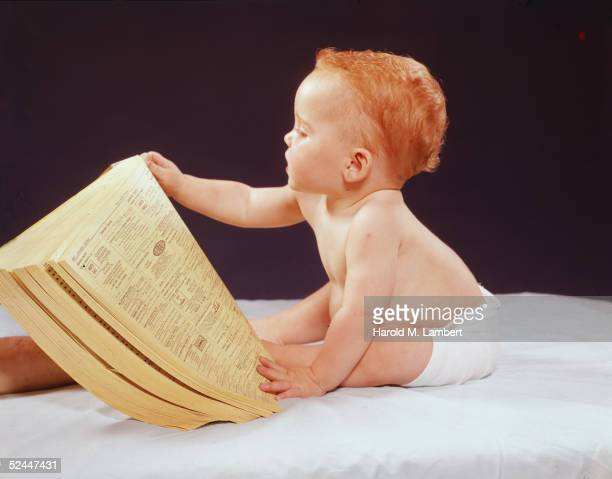Baby Reads The Telephone Book