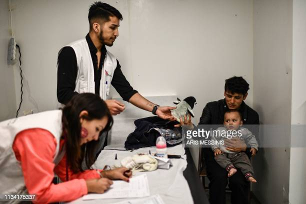 A baby receives treatment at the Doctors Without Borders clinic outside the refugee camp of Moria on the Greek island of Lesbos on March 19 2019 When...