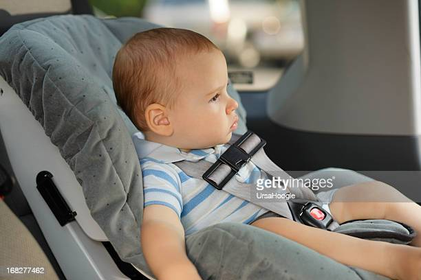 Baby riding in a front facing car seat