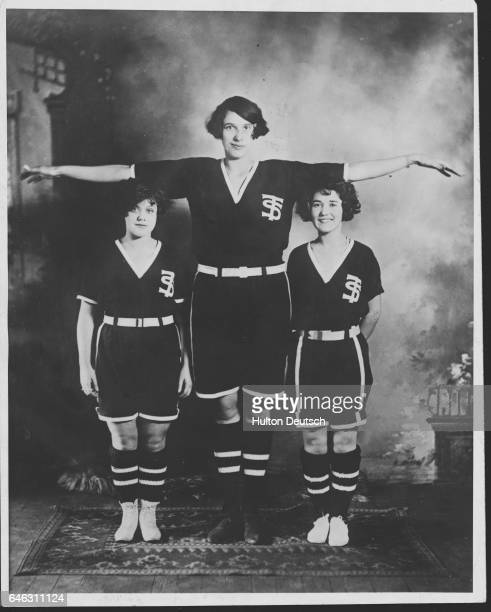 'Baby' Ruby a 6'4' tall basketball player stands with two of her teammates from the basketball team of Thompson Business College York Pa