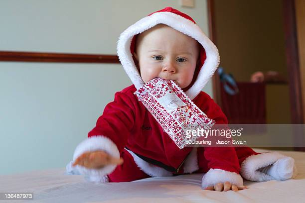 baby santa - totland bay stock pictures, royalty-free photos & images