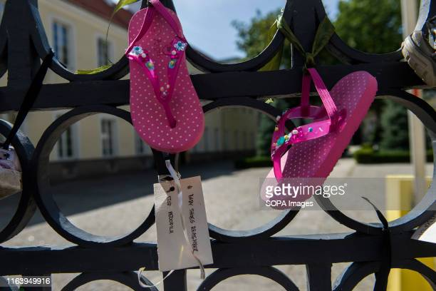 Baby shoes and a card that says Stop pedophilia hang at the gate of Warsaw Metropolitan Curia during the protest People all around Poland joined for...