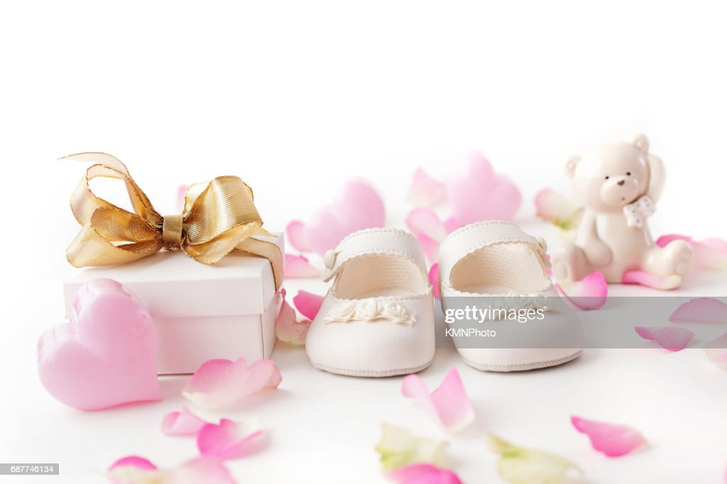 baby shoes and gift : Stock Photo