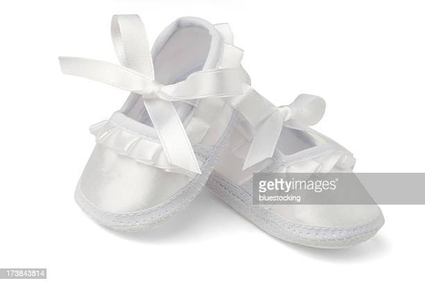 baby shoes isolated on white with clipping path - baby booties stock photos and pictures