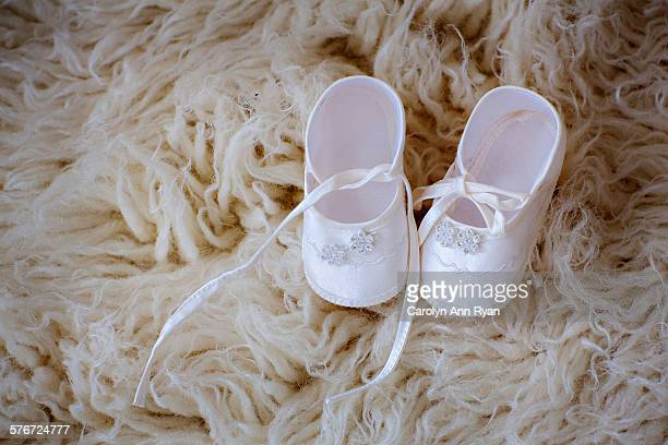 Baby shoes on flokati rug