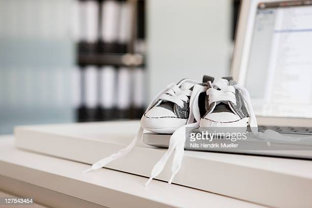 Baby shoes on laptop