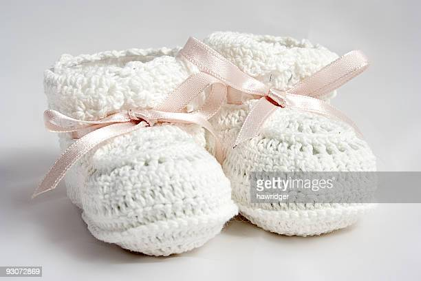 baby shoes - baby booties stock photos and pictures