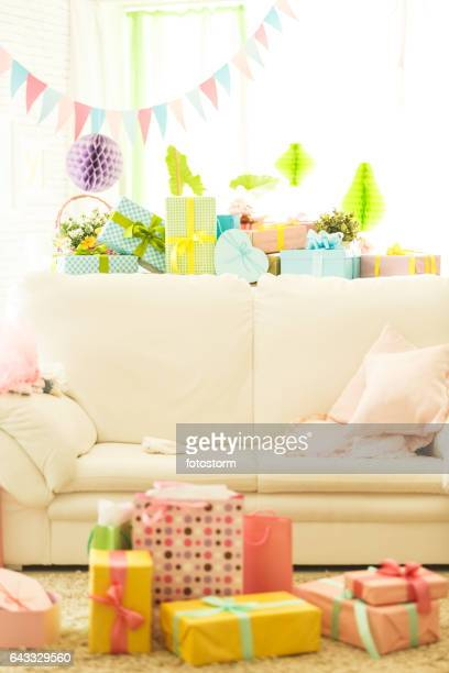 Baby shower party decorations and gifts in living room