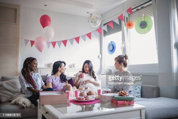 baby shower women - baby shower stock pictures, royalty-free photos & images