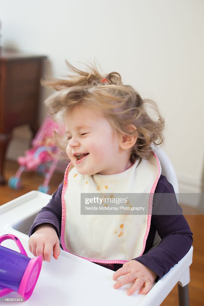 Baby sitting in highchair : Stock Photo