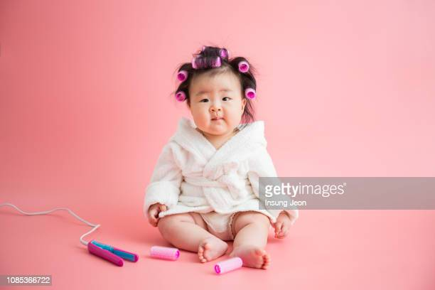 baby sitting on floor, wearing bathrobes. - baby girls stock pictures, royalty-free photos & images