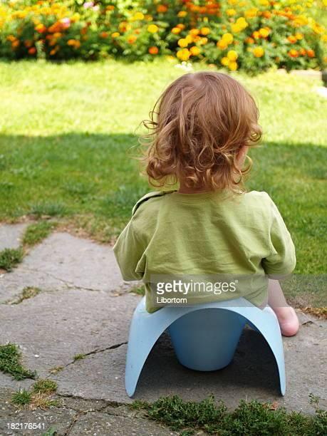 baby sitting on potty