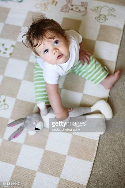 Baby sitting on the floor