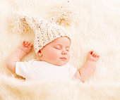 http://www.istockphoto.com/photo/baby-sleep-newborn-kid-in-woolen-hat-sleeping-on-white-fur-blanket-new-born-girl-gm941481162-257327562