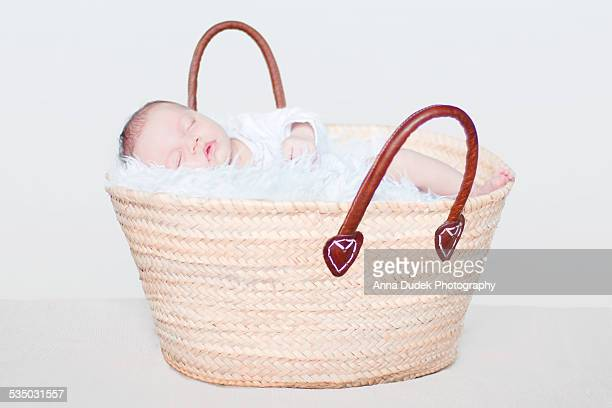 Baby sleeping in a shopping basket