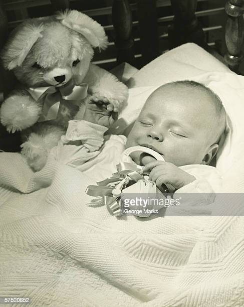 baby (0-3months) sleeping in crib, (b&w), close-up - 0 1 months stock pictures, royalty-free photos & images