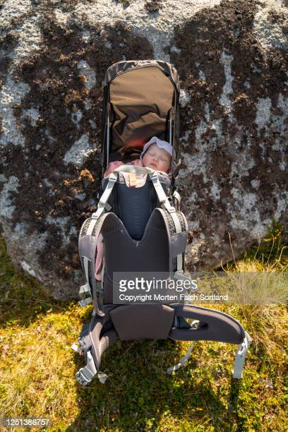 baby sleeping inside her baby carrier in bøstad, norway - rock baby sleep stock pictures, royalty-free photos & images