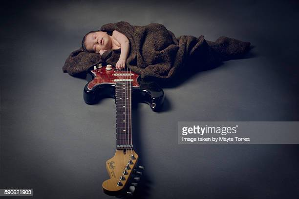 baby sleeping on guitar - rock baby sleep stock pictures, royalty-free photos & images