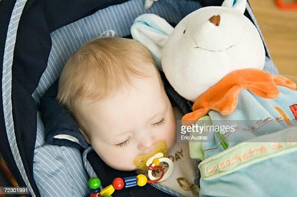 Baby sleeping, stuffed toy