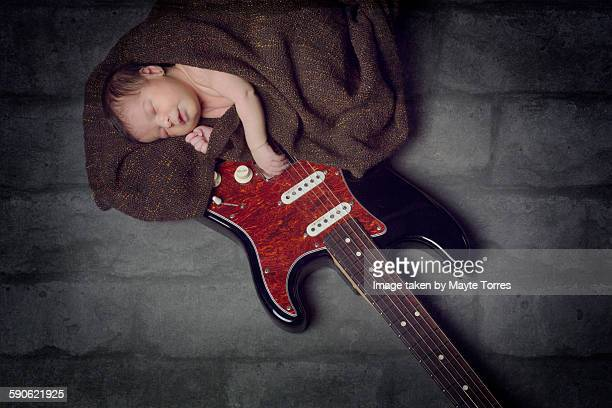 baby sleepting on guitar - rock baby sleep stock pictures, royalty-free photos & images