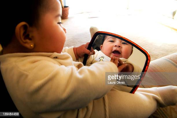 Baby smiles at her reflection