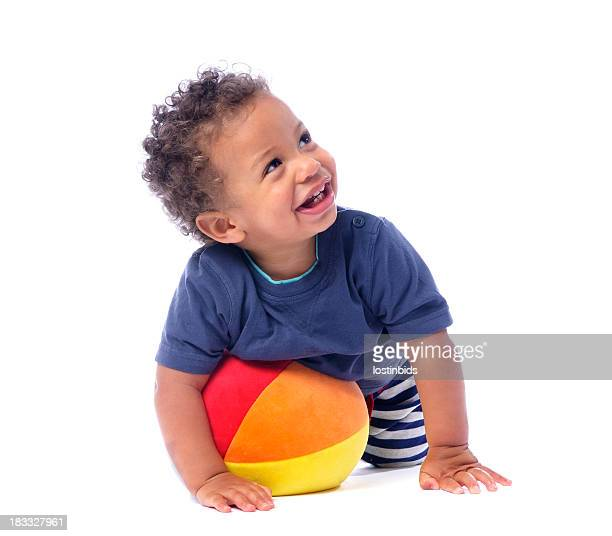 Baby Smiling And Looking Up While Playing With A Ball