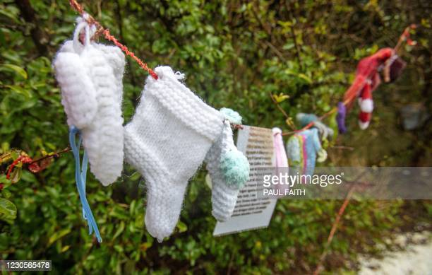 Baby socks and hearts are pictured at a shrine in Tuam, County Galway in January 13 erected in memory of up to 800 children who were allegedly buried...