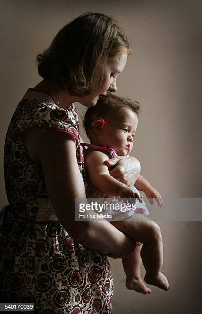Baby Soraya 10 months old with her mother Heather Wyndham Soraya was born deaf and had her cochlear implant turned on for the first time yesterday 11...