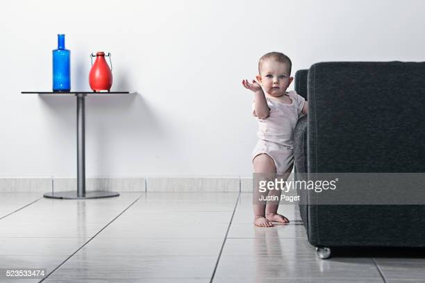 Baby Standing by Sofa