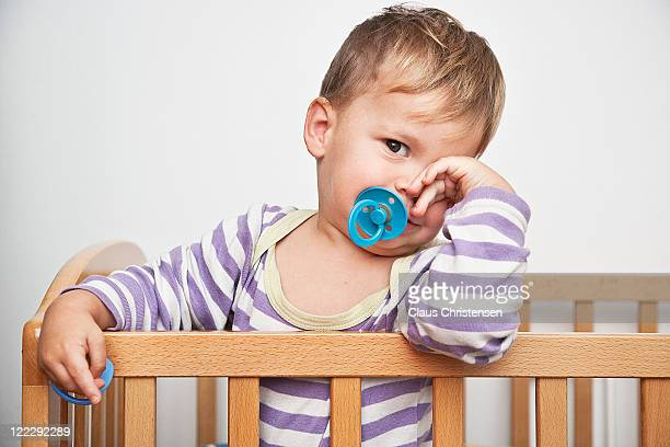 baby standing in his cradle