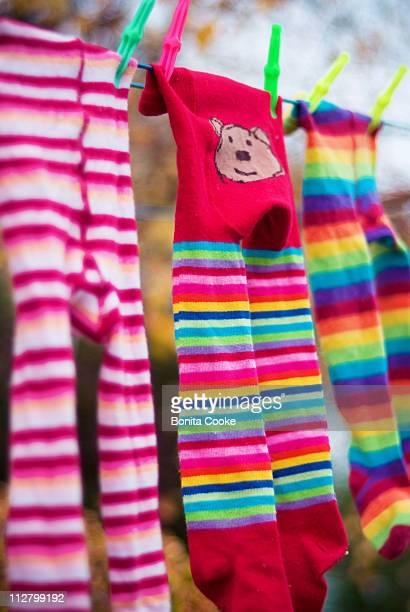 Baby stripe leggings on laundry washing line
